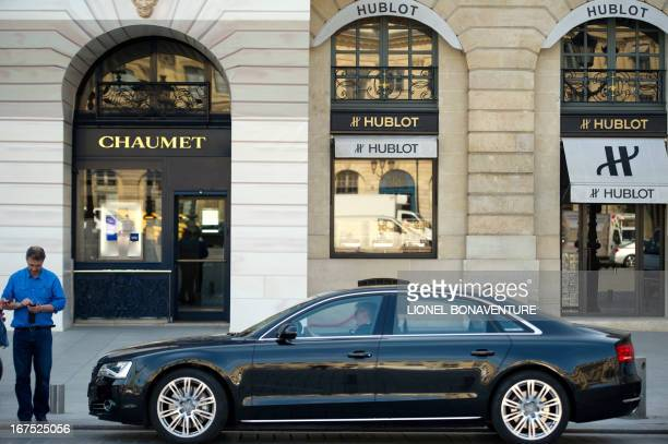 A car is parked in front of stores of watchmaking houses Chaumet and Hublot on April 26 2013 at the Place Vendome in Paris AFP PHOTO / LIONEL...