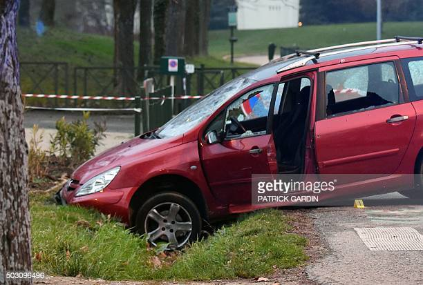 A car is pictured in front of the mosque of Valence southeastern France on January 1 after a soldier guarding the mosque shot and wounded a driver...