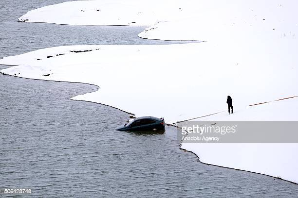 A car is pulled over from a lake after slipped on ice and fell into a lake in Turkey's Corum province on January 23 2016