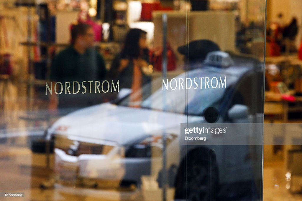 A car is reflected in the door of a Nordstrom Inc. department store as customers shop in Santa Monica, California, U.S., on Tuesday, Nov. 12, 2013. Nordstrom Inc. is scheduled to release earnings figures on Nov. 14. Photographer: Patrick T. Fallon/Bloomberg via Getty Images