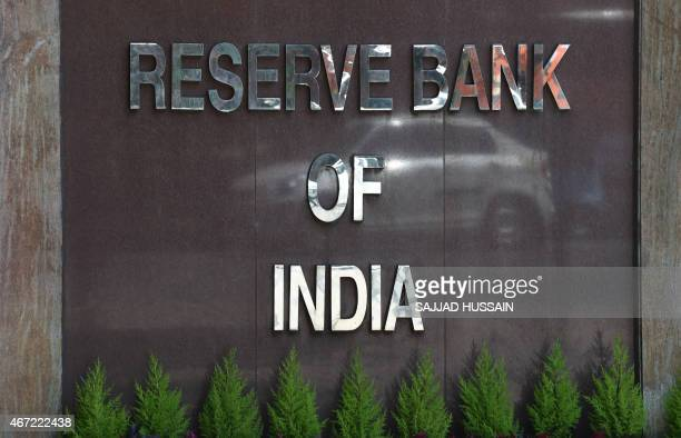 A car is reflected in the signage of the Reserve Bank of India sign during a meeting by Indian finance minister Arun Jaitley with the Central Board...