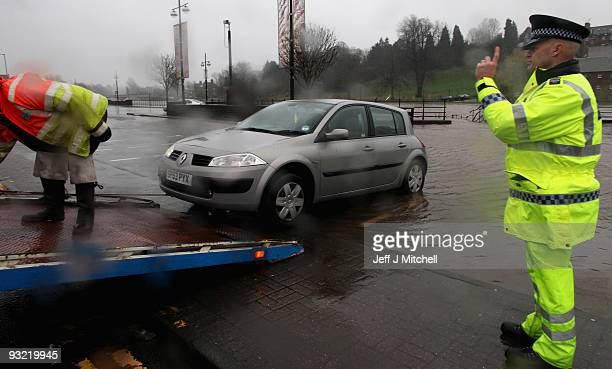A car is removed as Police close a car park in Dumfries as a high risk of flooding is forecast on November 19 2009 in Dumfries Scotland Much of south...