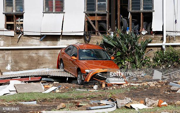 A car is seen among the debris of houses destroyed by cyclonic winds are seen on April 22 2015 in Dungog Australia Three people have died and more...