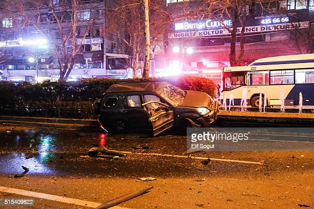 A car is seen burnt out after a blast on March 13 2016 in Ankara Turkey At least 27 people were killed and 75 wounded in an explosion in the Turkish...
