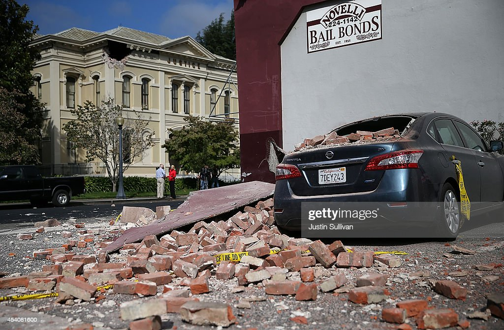 A car is seen covered in bricks following a reported 6.0 earthquake on August 24, 2014 in Napa, California. A 6.0 earthquake rocked the San Francisco Bay Area shortly after 3:00 am on Sunday morning causing damage to buildings and sending at least 70 people to a hospital with non-life threatening injuries.