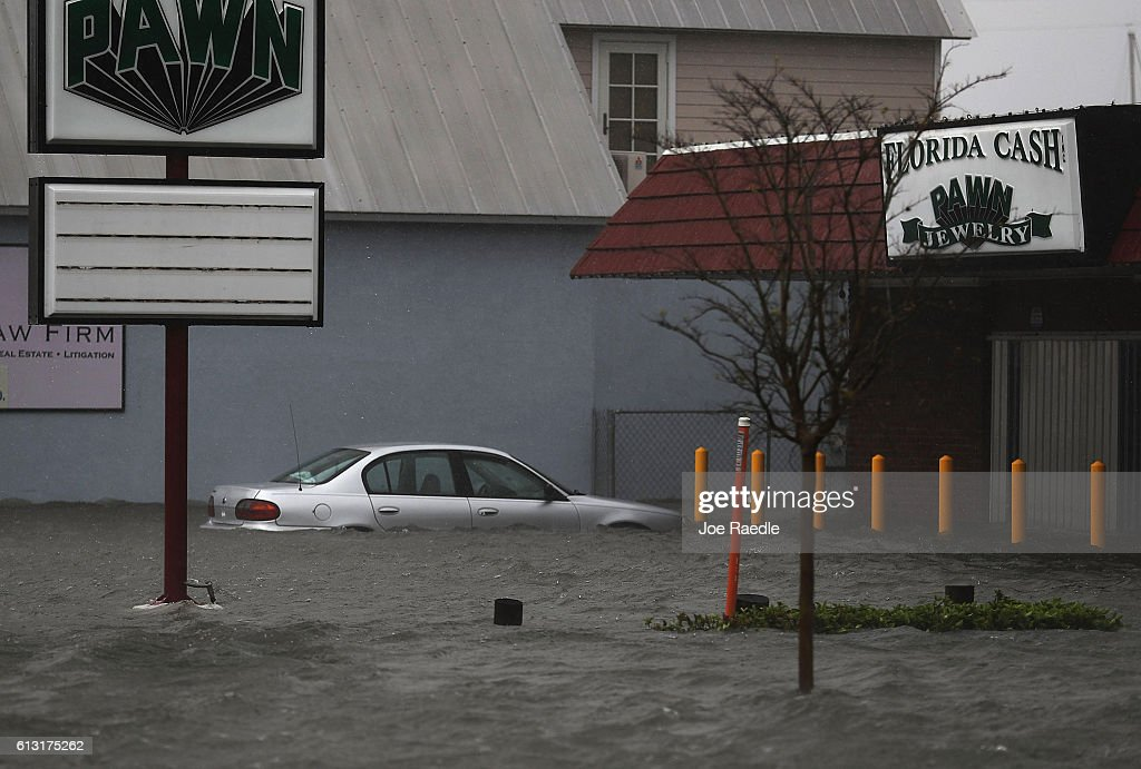A car is seen in a flooded parking lot as Hurricane Matthew passes through the area on October 7 2016 in St Augustine Florida Florida Georgia South...