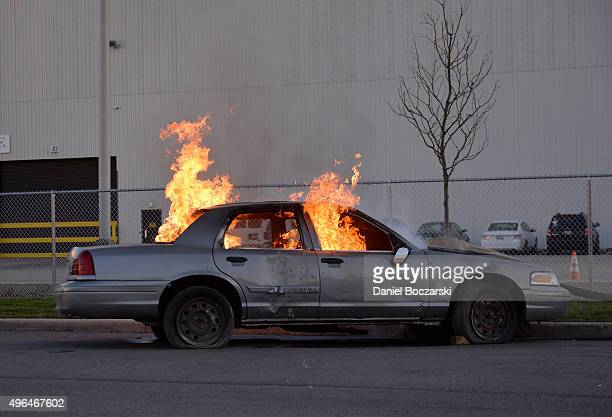 A car is set on fire at the on set demonstration of 'Chicago Fire' during the press junket for NBC's 'Chicago Fire' 'Chicago PD' and 'Chicago Med' at...