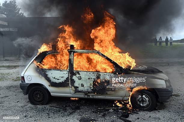 A car is set on fire during a crowd control exercise attended by more than 500 personnel from criminal investigation and police departments and...