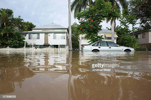 A car is submerged by flood waters on January 6 2011 in Rockhampton Australia All eyes are on the central Queensland city of Rockhampton currently in...
