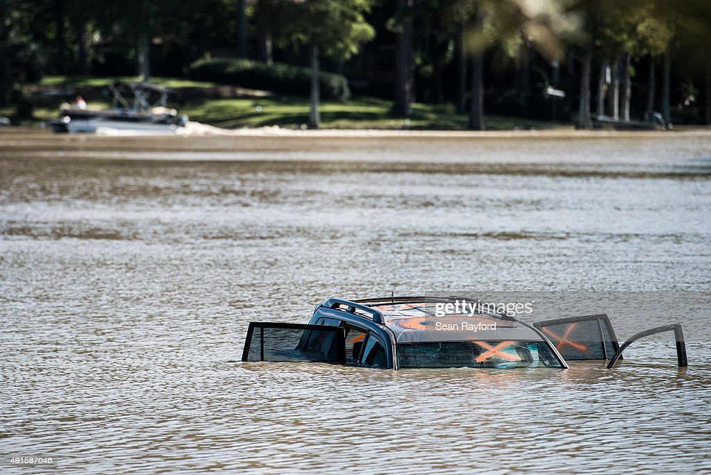 A car is submerged in Lake Katherine October 6 2015 in Columbia South Carolina The state of South Carolina experienced record rainfall amounts over...
