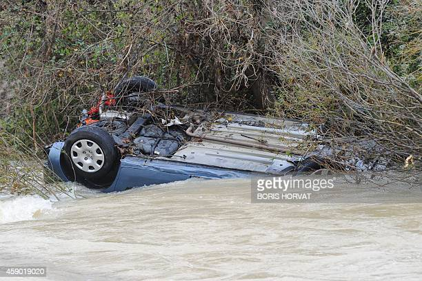A car is swept away by an overflooded river near CruviersLascours southern France on November 15 2014 A mother and her child were killed in the...