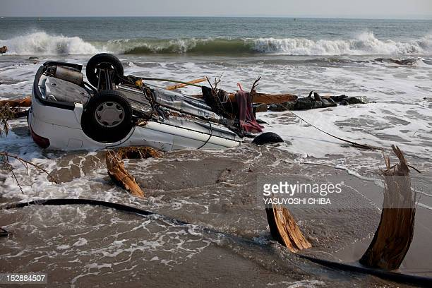 A car is washed in the shorebreak after the recent tsunami in Kesennuma city Miyagi prefecture on April 14 2011 Japan's seismologists were so...