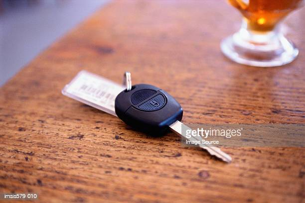 Car key and beer on counter