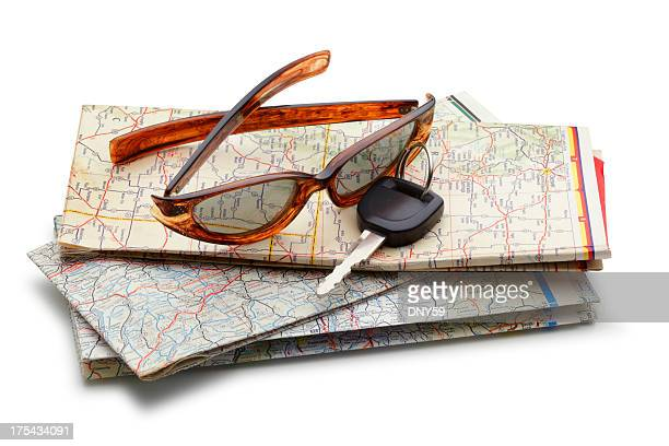 Car Key And Sunglasses On Road Map