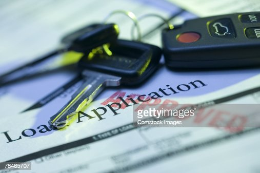 Car keys and approved loan application : Stock Photo