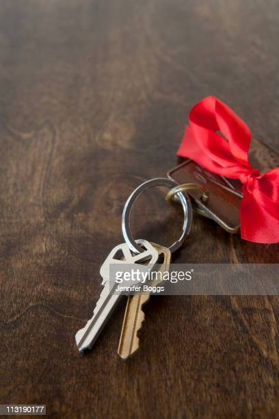 Car keys with red bow on key ring