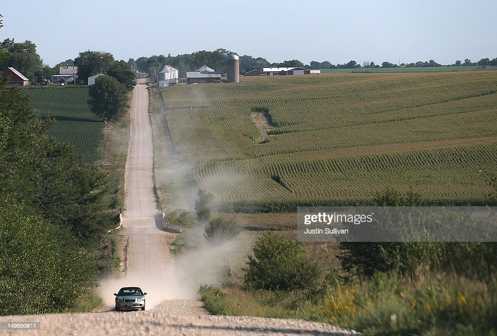 A car kicks up dust as it drives by corn fields on August 7, 2012 in State Center, Iowa. An exceptionally hot summer and the worst drought in more than a half century has caused cut prospects for the U.S. corn crop to a five-year low and has sent prices up to over $8.00 a bushel in late July trading. The price surge and limited supply has also prompted ethanol plants to voluntarily slow production by 20 percent, a two year low.