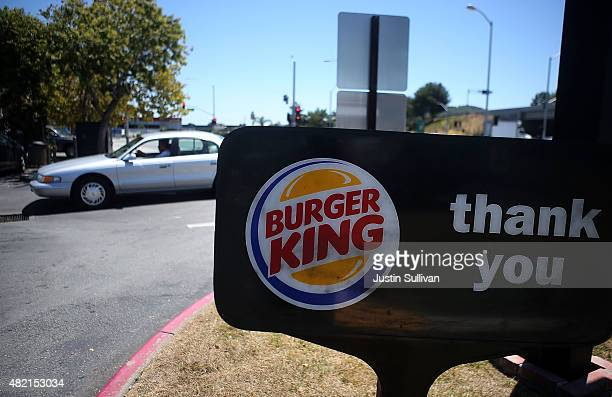 A car leaves a Burger King restaurant on July 27 2015 in San Rafael California Burger King parent company Restaurant Brands International reported a...
