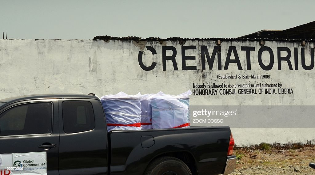 A car leaves the crematorium on March 7 2015 in Monrovia carrying barrels containing victims of Ebola's remains to a burial site 16 barrels...