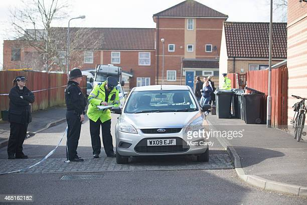 A car leaves through a police cordon set up around Barton Court on March 3 2015 in Bristol England Police investigating the disappearance of teenager...