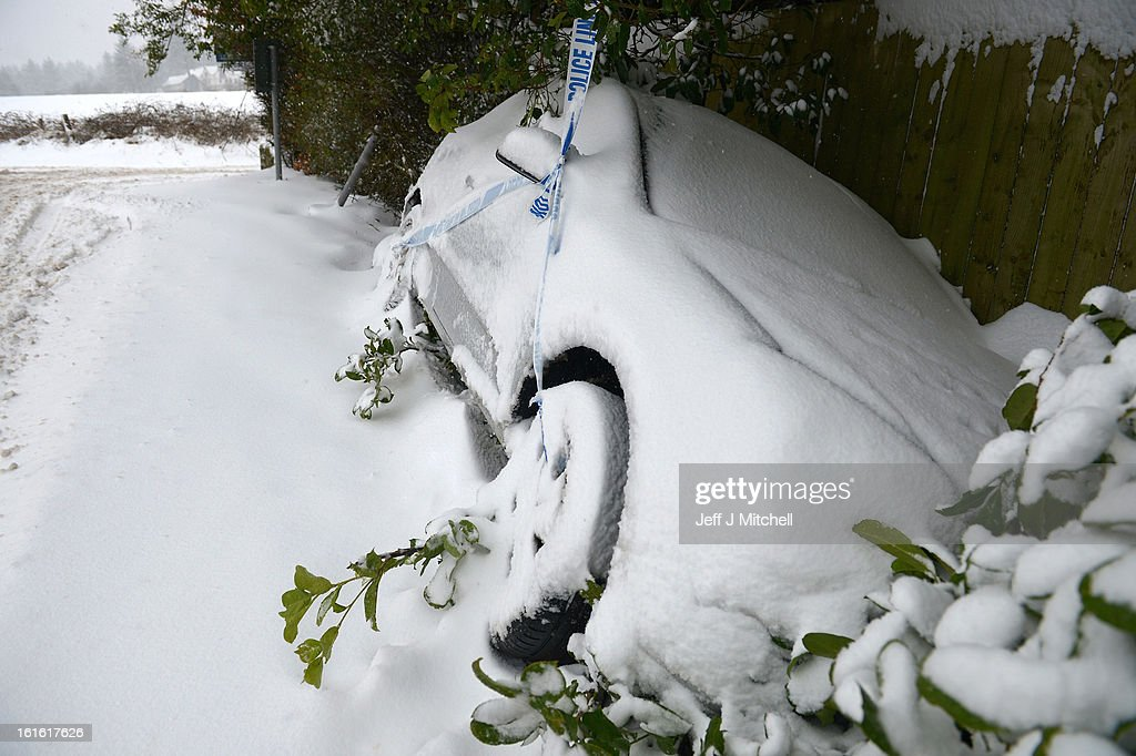 A car lies abandoned by the side of the road on February 13, 2013 in Blanefield, Scotland. Weather forecaster have issued a yellow weather warning of up to 10cm of snow on higher routes, with the possibility of travel disruption.