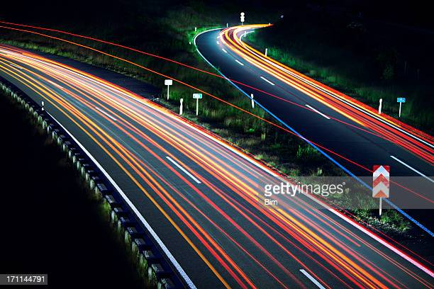 Car light trails on highway junction at night