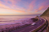 Car lights at sunset by the sea, Zumaia, Basque Country