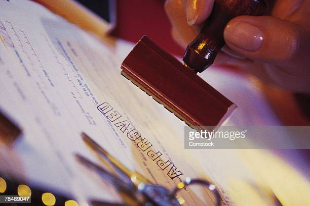 Car loan agreement stamped as approved