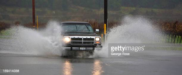A car makes its way across a flooded country road during a threeday storm as on December 2 2012 in Healdsburg California More than 18 inches of rain...