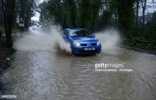 A car makes its way along a flooded road in Seaham as parts of the UK are braced for further flooding as successive bands of heavy rain move across...
