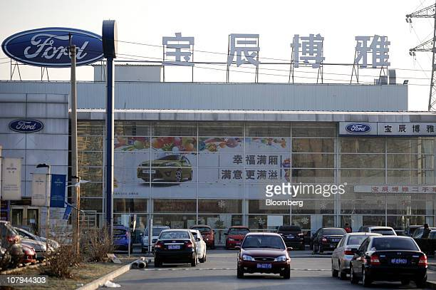 A car makes its way through the lot of a Ford Motor Co dealership in Beijing China on Friday Jan 7 2010 Ford Motor Co said its vehicle sales in China...