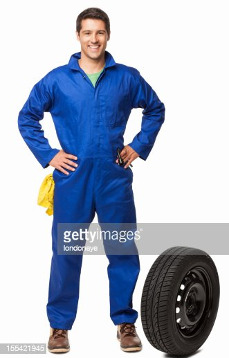 Car Mechanic And Spare Tire- Isolated