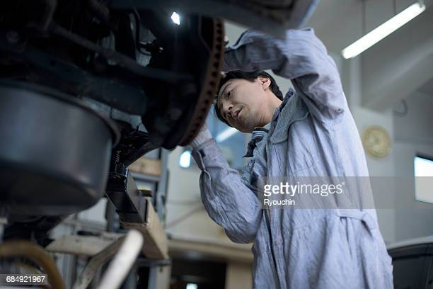Car mechanic. Car repair, Maintenance plant