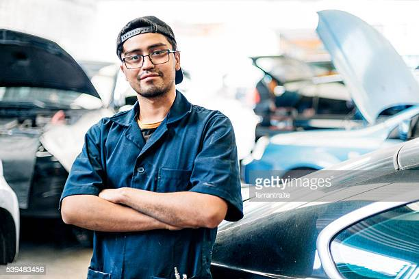 Car mechanic in auto repair shop