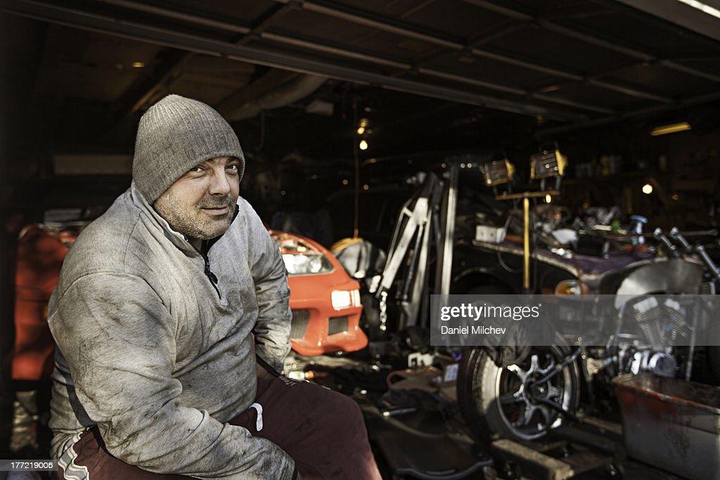 Car mechanic in his garage.