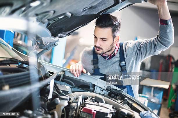 Car mechanic repair an engine.