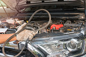 Car mechanic replacing timing belt