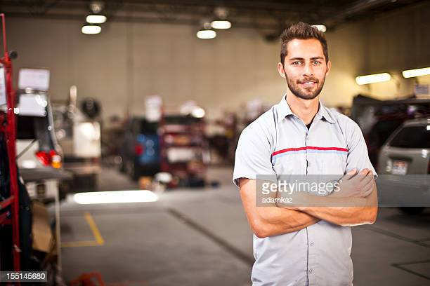 Car Mechanic Smiling with Arms Crossed