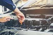 Car mechanic working in auto repair service