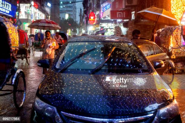 OLD DHAKA DHAKA BANGLADESH Car middle in the rain when heavy rainfall made in Dhaka city The death toll rises to 150 in several hill districts...
