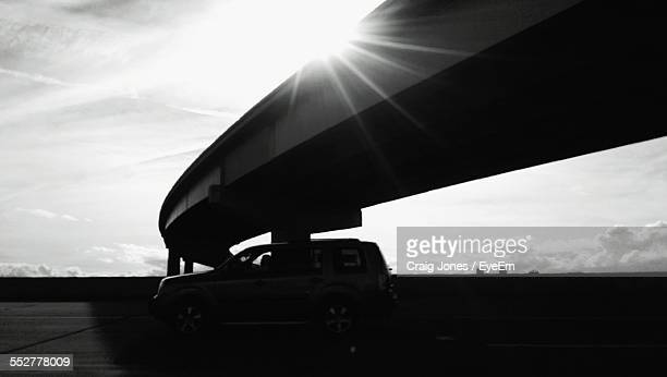 Car Moving Under Highway On Sunny Day