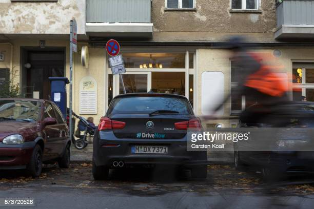 A car of the car sharing agency DriveNow is parked on a street on November 13 2017 in Berlin Germany A number of companies have plunged into the...