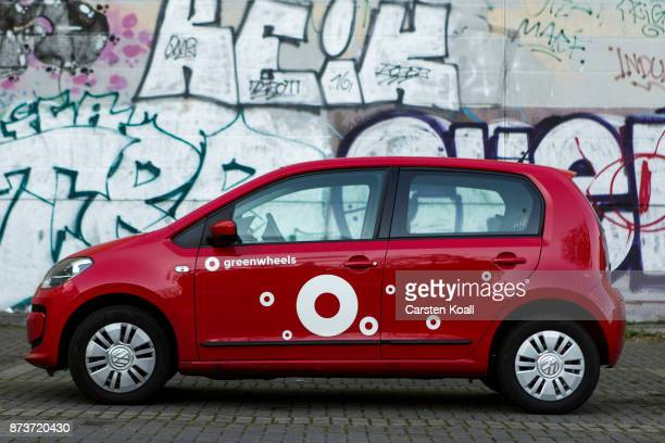 A car of the car sharing agency Greewheels is parked at the pickup and return station on November 13 2017 in Berlin Germany A number of companies...