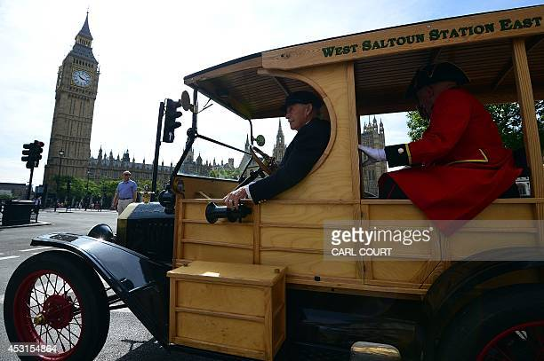 A car of World War 1 vintage carries Chelsea Pensioners British war veterens from the Chelsea Royal Hospital and friends past the Houses of...