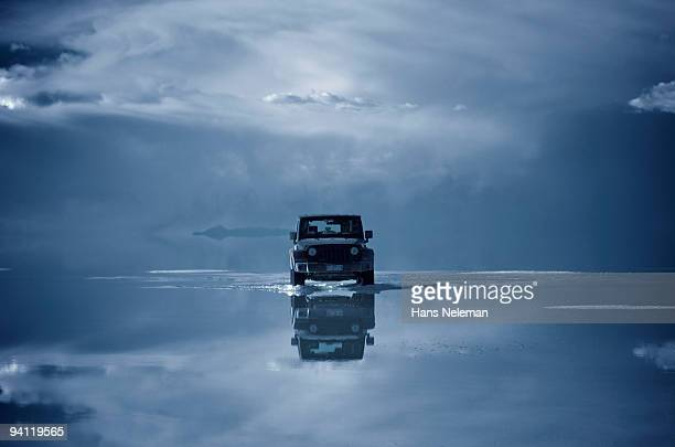 Car on a frozen lake, Salar De Uyuni, Altiplano, Bolivia