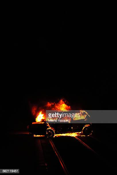 Car on fire in the street