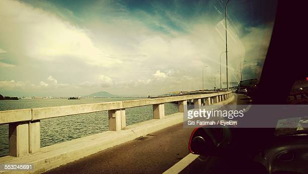 Car On Penang Bridge Against Cloudy Sky