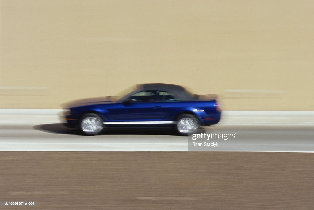 Car on road, blurred motion : Stock Photo