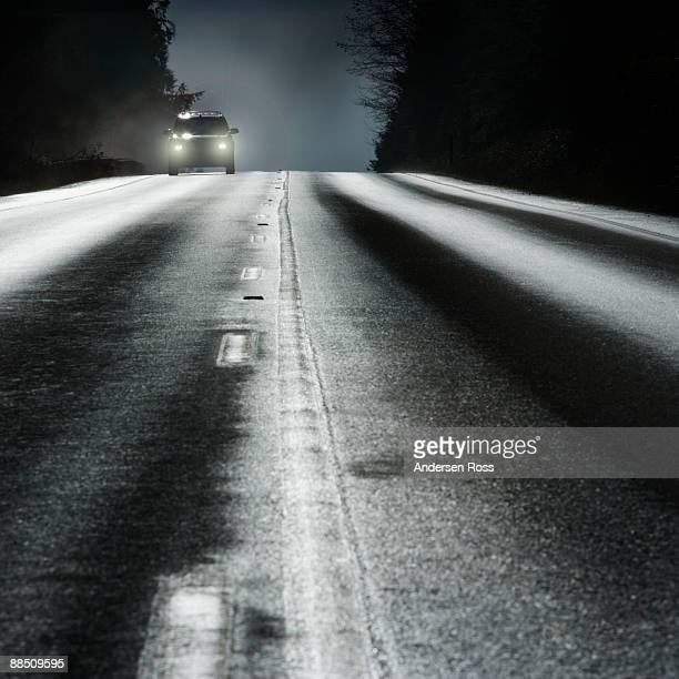 Car on road with headlights