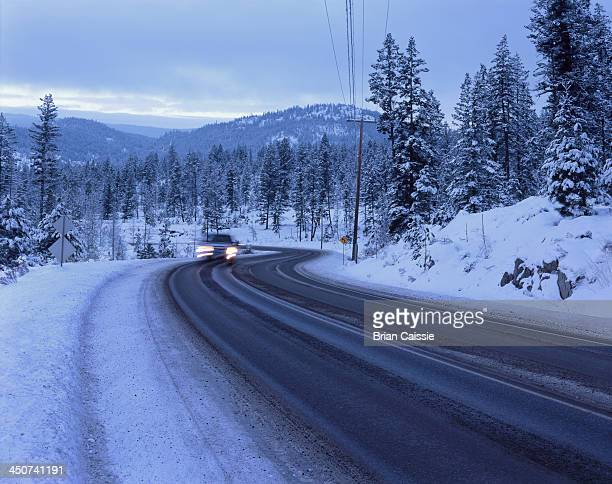 Car on snowy mountain road at Sunpeaks resort in Kamloops, British Columbia, Canada